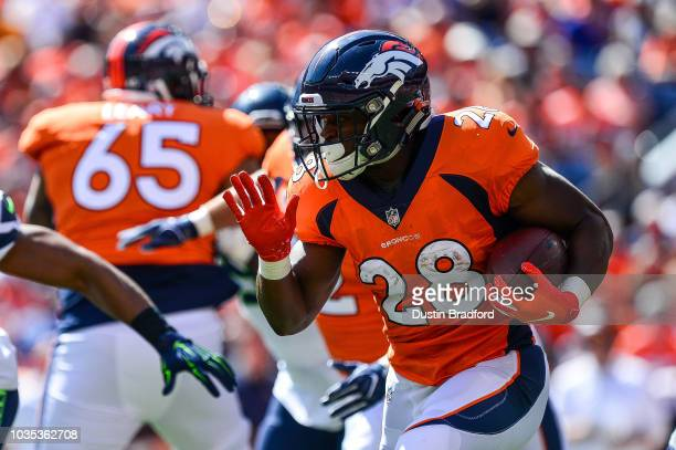 c2f71255c Running back Royce Freeman of the Denver Broncos carries the ball against  the Seattle Seahawks at