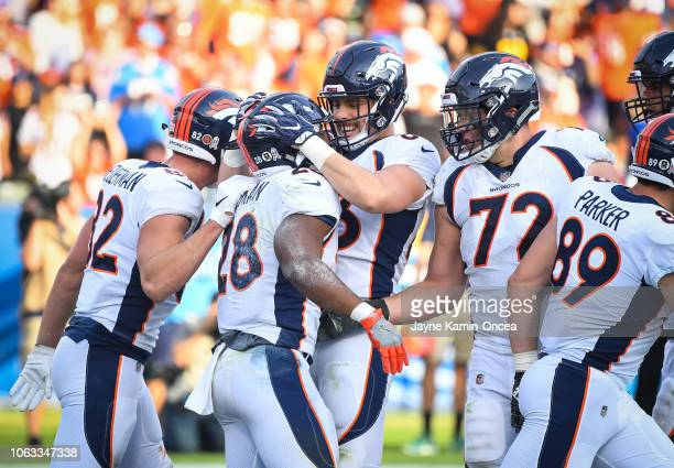 Running back Royce Freeman of the Denver Broncos celebrates his touchdown with tight end Matt LaCosse to trail 1914 in the third quarter against the...