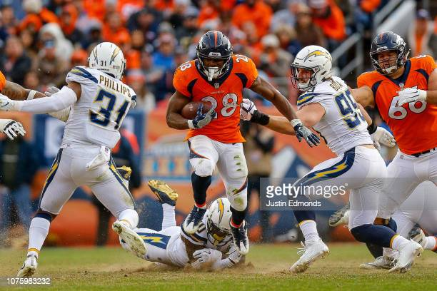 Running back Royce Freeman of the Denver Broncos escapes a tackle attempt by linebacker Hayes Pullard of the Los Angeles Chargers in the second...