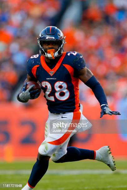 Running back Royce Freeman of the Denver Broncos runs with the football against the Tennessee Titans during the fourth quarter at Empower Field at...