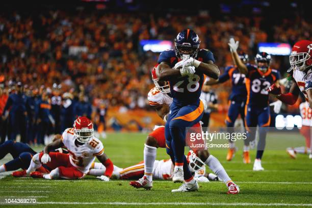 Running back Royce Freeman of the Denver Broncos rushes for a second-quarter touchdown against the Kansas City Chiefs at Broncos Stadium at Mile High...