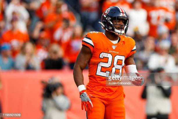 Running back Royce Freeman of the Denver Broncos stands in the end zone after scoring a touchdown against the Detroit Lions during the second quarter...
