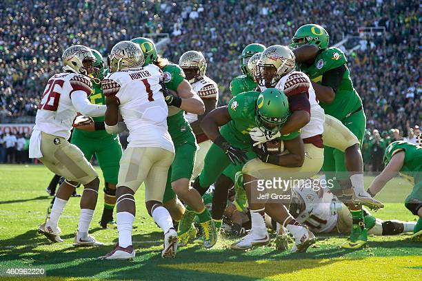 Running back Royce Freeman of the Oregon Ducks rushes for a oneyard touchdown against the Florida State Seminoles in the first quarter of the College...