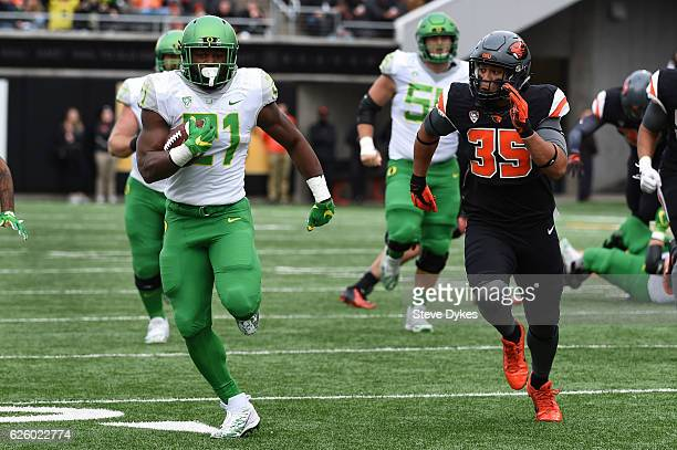 Running back Royce Freeman of the Oregon Ducks tries to out run linebacker Caleb Saulo of the Oregon State Beavers during the second quarter of the...
