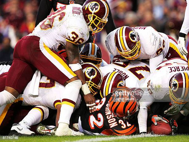 Running back Rudi Johnson of the Cincinnati Bengals attempts to score a touchdown against the Washington Redskins during the first half of the game...