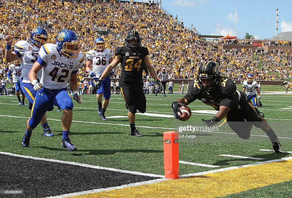 Running back Russell Hansbrough #32 of the Missouri Tigers dives into the end zone for a touch down against the South Dakota State Jackrabbits in the first quarter at Memorial Stadium on August 30, 2014 in Columbia, Missouri.