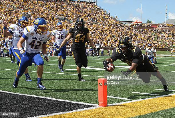 Running back Russell Hansbrough of the Missouri Tigers dives into the end zone for a touch down against the South Dakota State Jackrabbits in the...