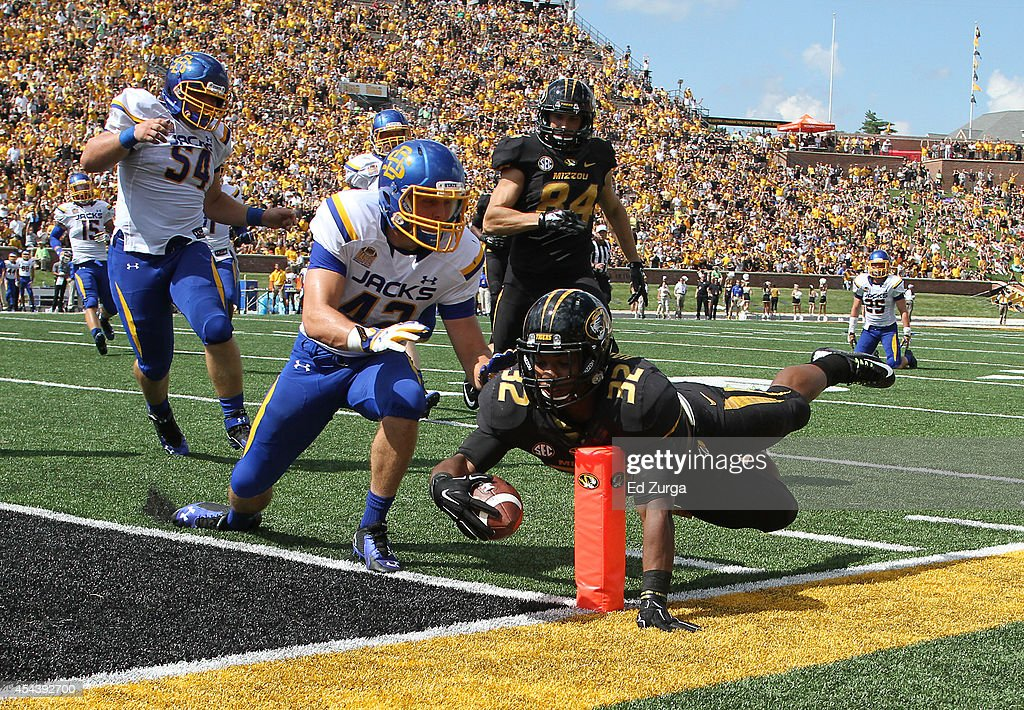 Running back Russell Hansbrough #32 of the Missouri Tigers dives into the end zone for a touch down against the Nick Mears #42 of the South Dakota State Jackrabbits in the first quarter at Memorial Stadium on August 30, 2014 in Columbia, Missouri.