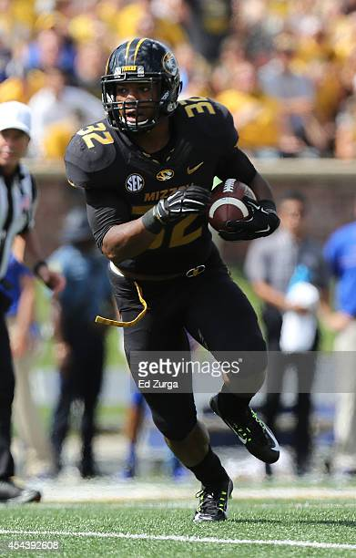 Running back Russell Hansbrough of the Missouri Tigers runs for a 10yard touchdown against the South Dakota State Jackrabbits in the first quarter at...