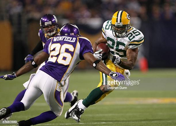Running back Ryan Grant of the Green Bay Packers carries the ball against cornerback Antoine Winfield of the Minnesota Vikings on November 9 2008 at...