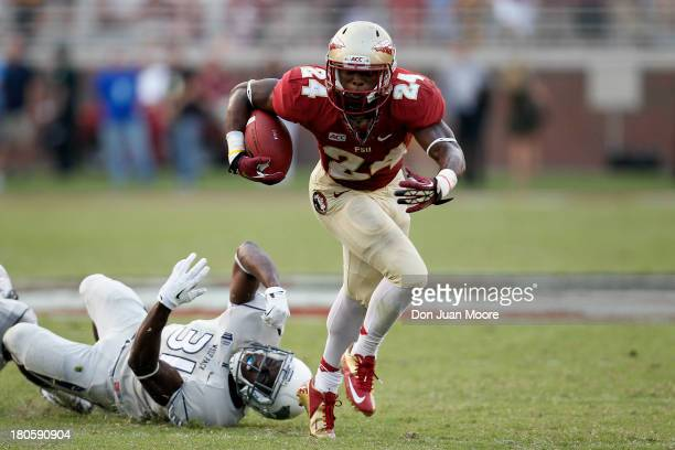 Running back Ryan Green of the Florida State Seminoles breaks a tackle by Safety Randy Uzoma of the Nevada Wolf Pack during the game at Doak Campbell...