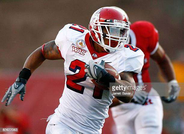 Running back Ryan Mathews of the Fresno State Bulldogs runs upfield in the second half against the Rutgers Scarlet Knights at Rutgers Stadium on...