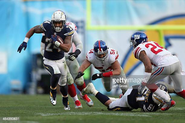 Running back Ryan Mathews of the San Diego Chargers is pursued by Spencer Paysinger and Terrell Thomas of the New York Giants in the second half at...