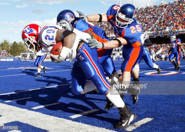 Running back Ryan Moats of Louisiana Tech is pushed out of bounds by Korey Hall of Boise State during the first quarter at Bronco Stadium on November...