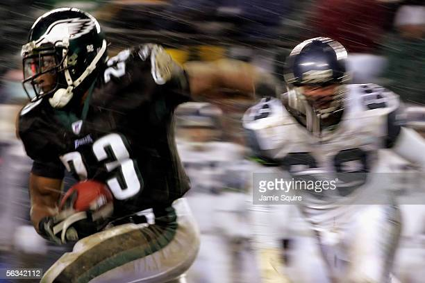 Running back Ryan Moats of the Philadelphia Eagles is chased by John Tafoya of the Seattle Seahawks in the third quarter of the game on December 5,...