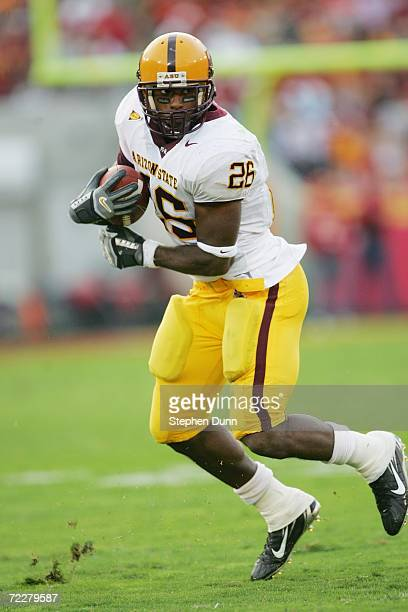 Running back Ryan Torain of the Arizona State Sun Devils carries the ball against the USC Trojans at the Los Angeles Memorial Coliseum on October 14...