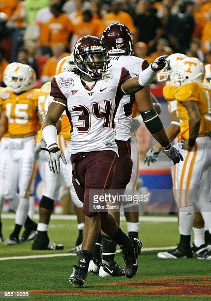 Running back Ryan Williams of the Virginia Tech Hokies celebrates his first quarter touchdown during the ChickFilA Bowl against the Tennessee...