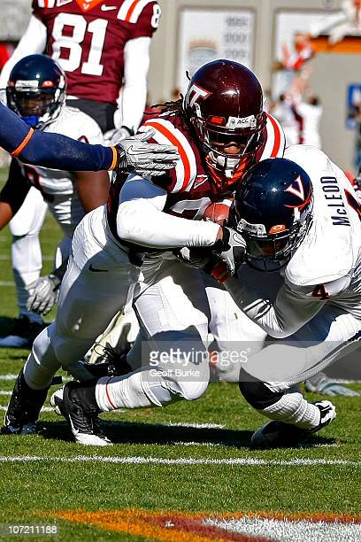 Running back Ryan Williams of the Virginia Tech Hokies runs with the ball to score a touchdown as cornerback Rodney McLeod of the Virginia Cavaliers...