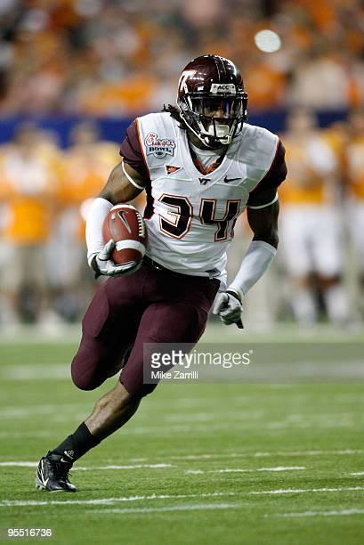Running back Ryan Williams of the Virginia Tech Hokies runs with the ball during the ChickFilA Bowl against the Tennessee Volunteers at the Georgia...