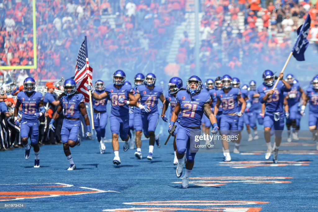 Running back Ryan Wolpin #21 of the Boise State Broncos carries the hammer and leads the Broncos into the stadium prior to that start of first half action against the Troy Trojans on September 2, 2017 at Albertsons Stadium in Boise, Idaho.