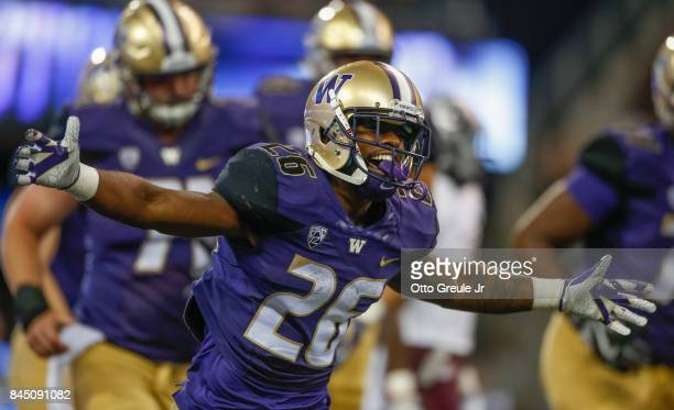 Running back Salvon Ahmed of the Washington Huskies reacts after scoring a touchdown against the Montana Grizzlies at Husky Stadium on September 9...