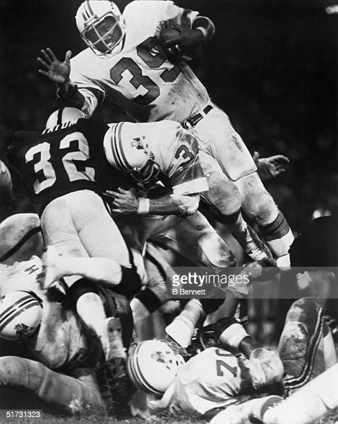 Running back Sam Cunningham of the New England Patriots jumps over the line of scrimmage during a game against the Oakland Raiders circa 19731982