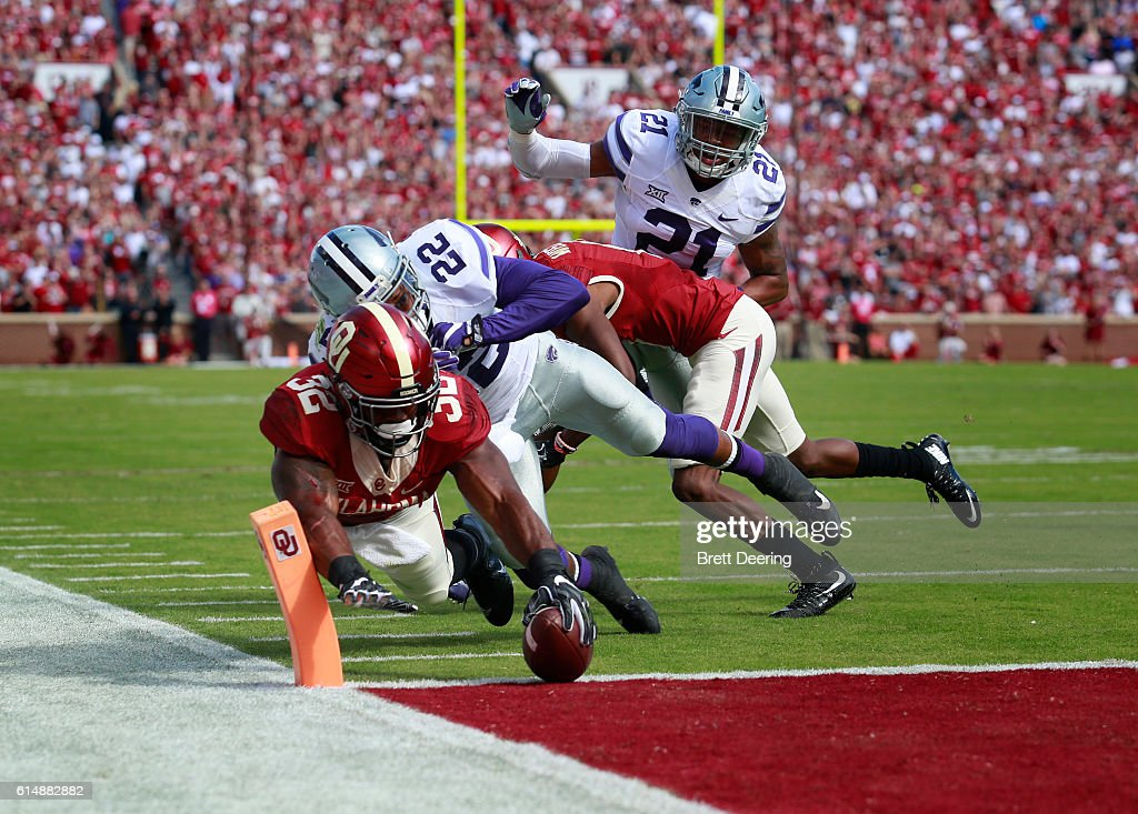 Running back Samaje Perine #32 of the Oklahoma Sooners reaches for a touchdown as he is hit by defensive back Dante Barnett #22 of the Kansas State Wildcats October 15, 2016 at Gaylord Family-Oklahoma Memorial Stadium in Norman, Oklahoma.
