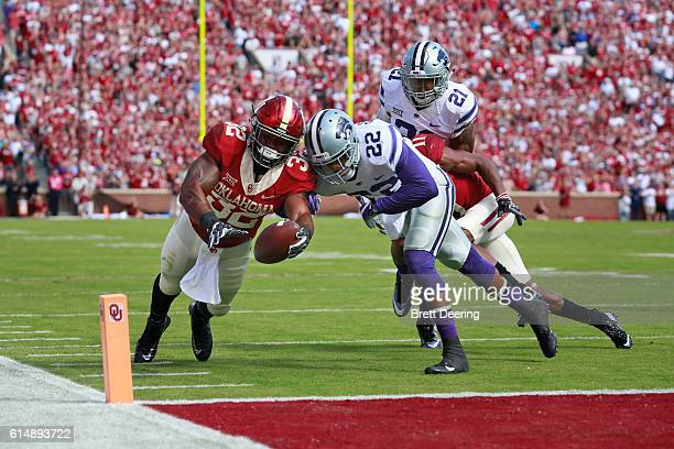 Running back Samaje Perine of the Oklahoma Sooners reaches for a touchdown as he is chased by defensive back Dante Barnett and defensive back Kendall...