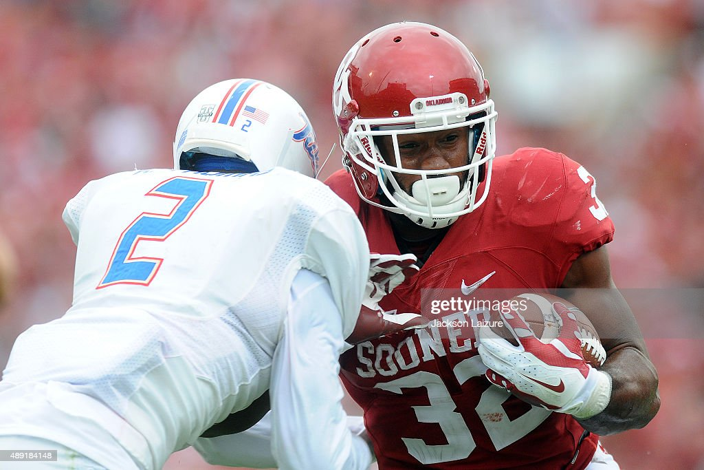 Running back Samaje Perine #32 of the Oklahoma Sooners runs past cornerback Kerwin Thomas #2 against the Tulsa Golden Hurricane at Gaylord Family Memorial Stadium on September 19, 2015 in Norman, Oklahoma.