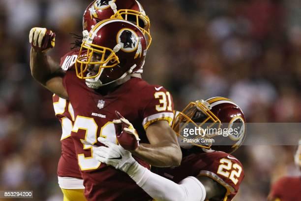 Running back Samaje Perine of the Washington Redskins celebrates strong safety Deshazor Everett of the Washington Redskins in the second quarter of...