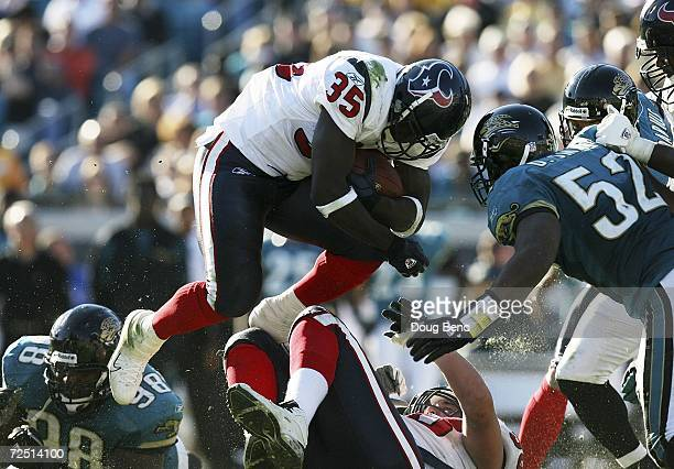Running back Samkon Gado of the Houston Texans is met in the air by linebacker Daryl Smith of the Jacksonville Jaguars at Alltel Stadium on November...