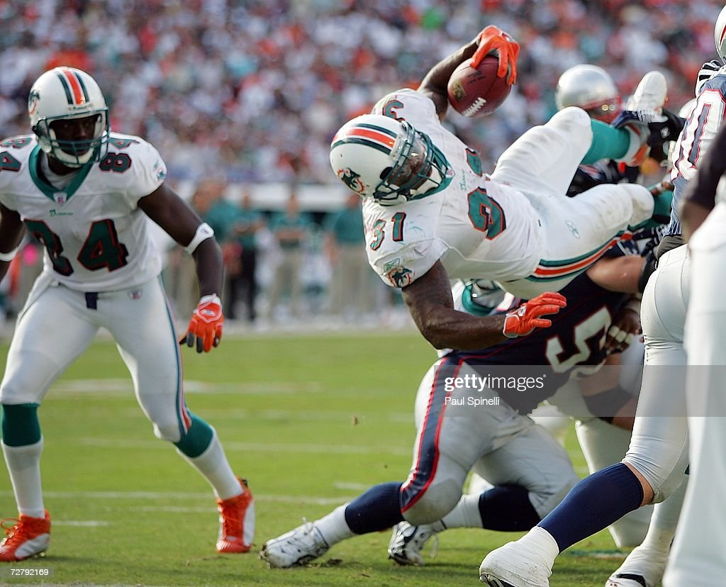 Running back Sammy Morris #31 of the Miami Dolphins dives for the game clinching touchdown against the New England Patriots at Dolphin Stadium on December 10, 2006 in Miami, Florida. The Dolphins defeated the Patriots 21-0.