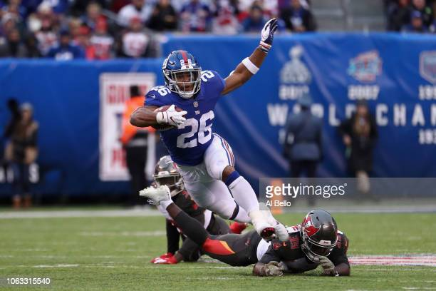 Running back Saquon Barkley of the New York Giants carries the ball for a long run against the Tampa Bay Buccaneers during the third quarter at...