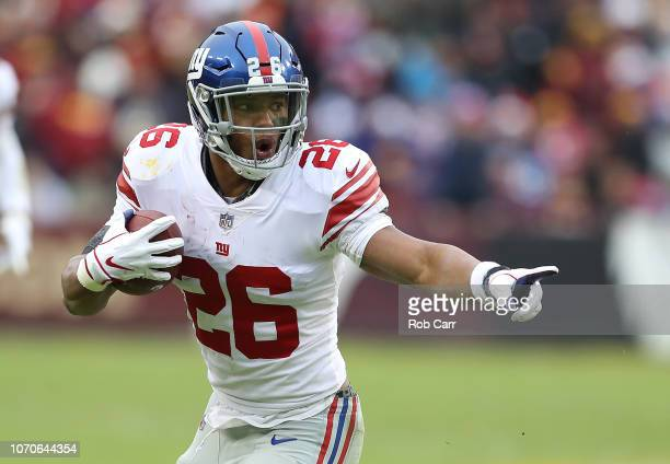 Running back Saquon Barkley of the New York Giants carries the ball in the second quarter against the Washington Redskins at FedExField on December 9...