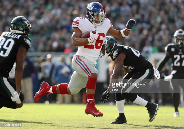 Running back Saquon Barkley of the New York Giants runs the ball in to score a touchdown against the Philadelphia Eagles during the first quarter at...