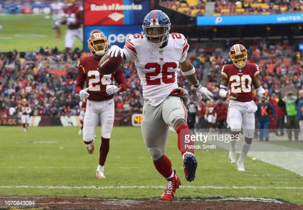 Running back Saquon Barkley of the New York Giants rushes for a 78yard touchdown in the second quarter against the Washington Redskins at FedExField...