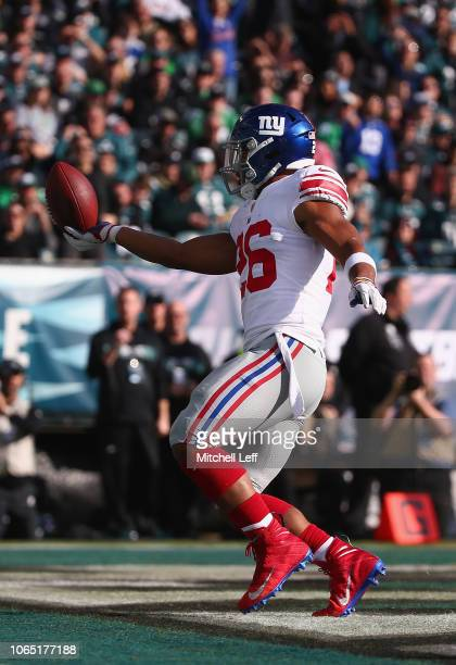Running back Saquon Barkley of the New York Giants scores a touchdown against the Philadelphia Eagles during the first quarter at Lincoln Financial...