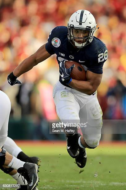 Running back Saquon Barkley of the Penn State Nittany Lions carries the ball in the first half against the USC Trojans during the 2017 Rose Bowl Game...