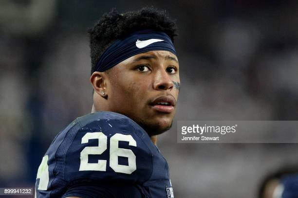 Running back Saquon Barkley of the Penn State Nittany Lions looks on during the second half of the PlayStation Fiesta Bowl against the Washington...