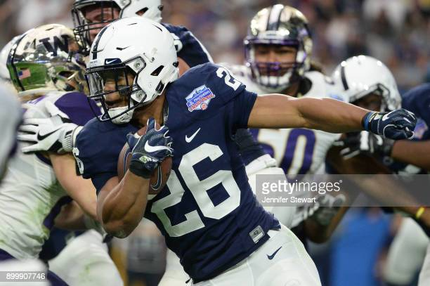 Running back Saquon Barkley of the Penn State Nittany Lions runs the football 92 yards to score a touchdown against the Washington Huskies during the...
