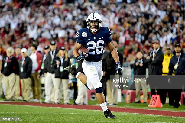 Running back Saquon Barkley of the Penn State Nittany Lions rushes for a 79-yard touchdown in the third quarter against the USC Trojans during the...