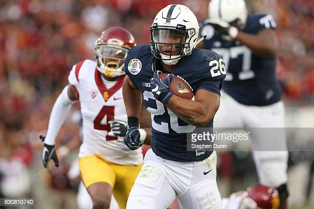 Running back Saquon Barkley of the Penn State Nittany Lions scores on a 24yard touchdown run in the first half against USC Trojans during the 2017...