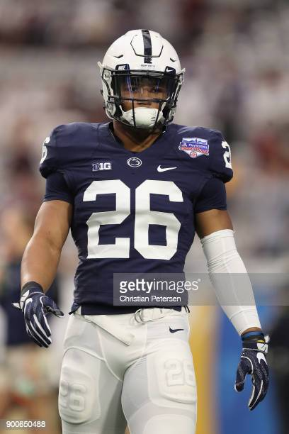 Running back Saquon Barkley of the Penn State Nittany Lions warms up before the Playstation Fiesta Bowl against the Washington Huskies at University...