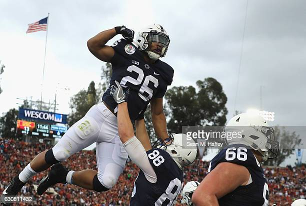 Running back Saquon Barkley of the Penn State Nittany Lions celebrates with tight end Mike Gesicki after scoring on a 24yard touchdown run in the...