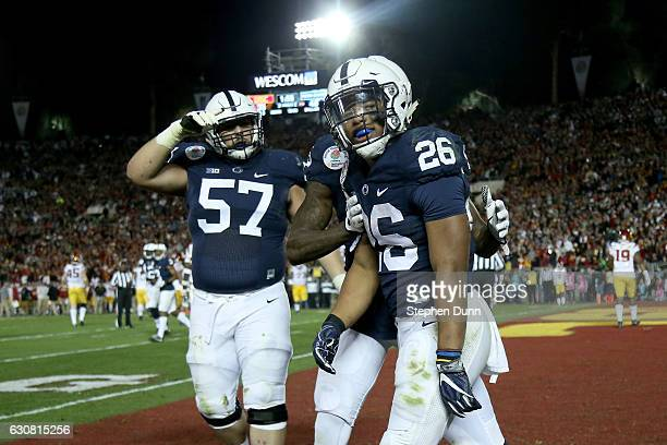 Running back Saquon Barkley of the Penn State Nittany Lions celebrates with teammates after making a 7yard touchdown reception in the third quarter...