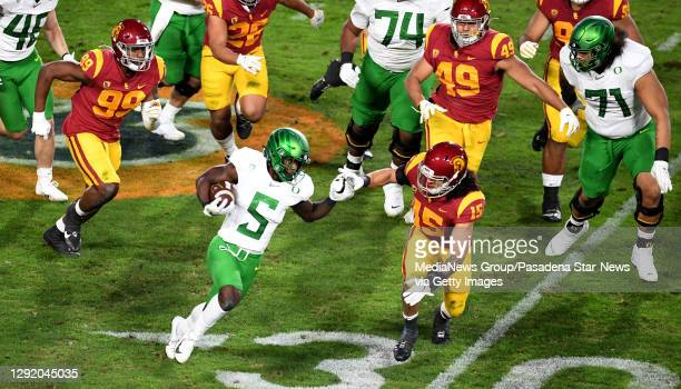 Running back Sean Dollars of the Oregon Ducks runs for a first down against the USC Trojans in the first half of the PAC 12 Championship football...