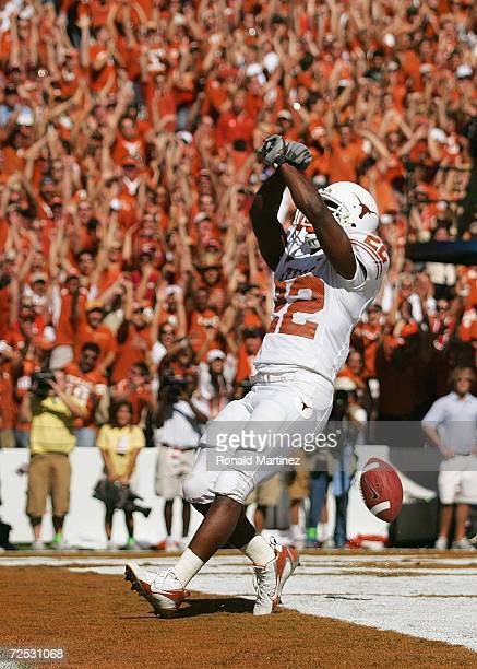Running back Selvin Young of the Texas Longhorns celebrates in the endzone after scoring a touchdown against the Oklahoma Sooners during the Red...