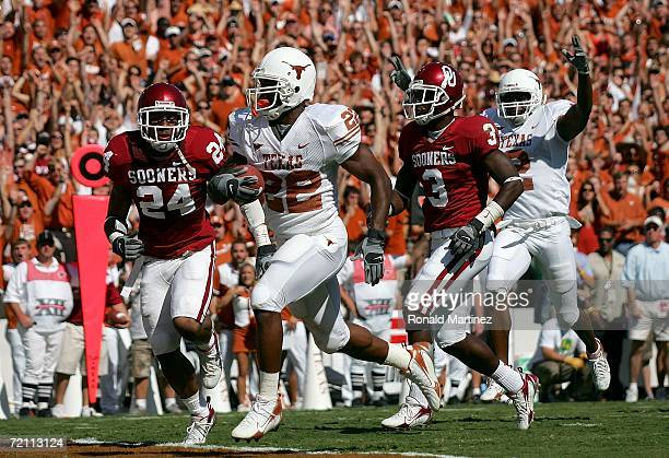 Running back Selvin Young of the Texas Longhorns runs for a touchdown against the Oklahoma Sooners during the Red River Shootout at the Cotton Bowl...