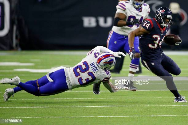 Running back Senorise Perry of the Buffalo Bills avoids the tackle by Micah Hyde of the Buffalo Bills during the AFC Wild Card Playoff game at NRG...