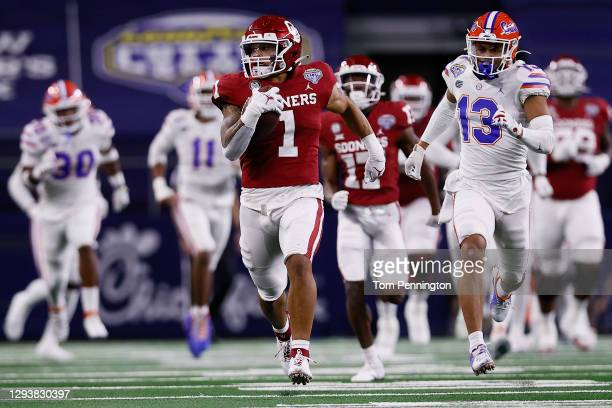 Running back Seth McGowan of the Oklahoma Sooners runs against the Florida Gators during the third quarter at AT&T Stadium on December 30, 2020 in...